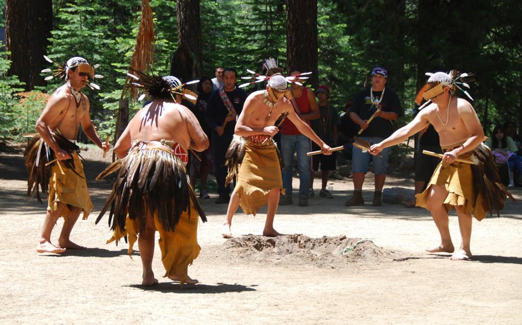 Five Native American men in traditional dance