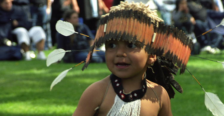 Native American young boy with headdress
