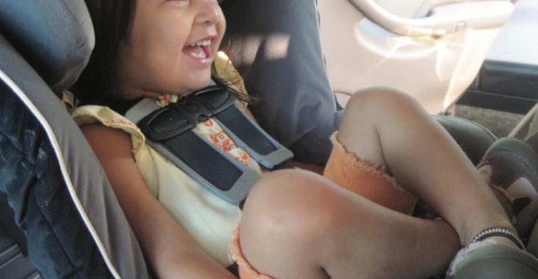 girl in car seat