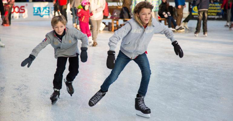 2 boys Ice skating
