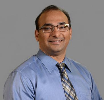 a headshot of Dr. Karthik Raghuraman