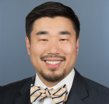 a headshot of Christopher Kim