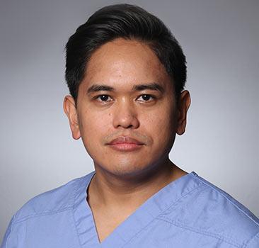 a headshot of Alvin Buniag