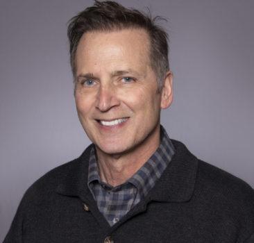 a headshot of Dennis