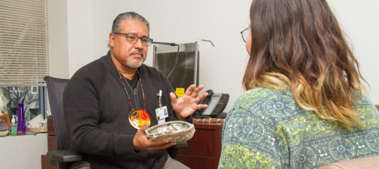 Older traditional leader and behavioral health clinician with a patient