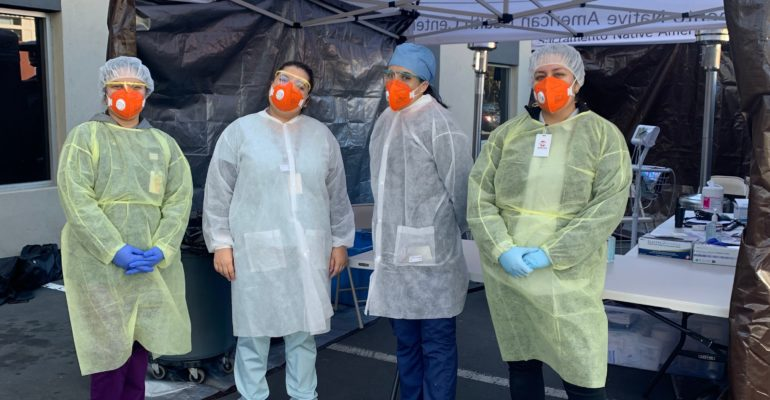 SNAHC Staff standing in front of a SNAHC Triage Tent